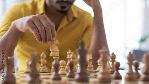 Canvas Print Man playing chess at home