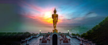 Golden Buddha Image Standing With Sunrise In The Early Morning At Wat Phra That Khao Noi Temple, Nan Province, Thailand.