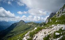 The High Plateau Of Montasio With Green Pastures In Summer And Julian Alps (Jof Di Montasio). Udine, Friuli Venezia Giulia, Italy, Europe