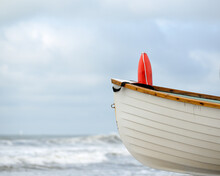 Wooden Lifeboat On The Beach Ready For Life Saving