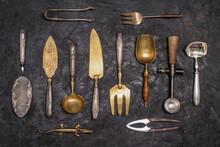 Vintage Kitchen Utensils And Silverware On Black Background. Retro Background.