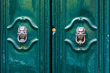 Door Knocker Like Antique Head On The Entrance Of A House, Old Ornate Metal Door Handle