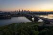 wieżowce w cetrum Warszawy, rzeka Wisła, plaża o zachodzie słońca z lotu ptaka, dron