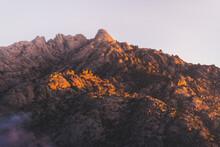 Rough Mountain Range Under Light Sky In Morning