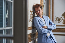 Depressed Man In Suit In Luxury Room