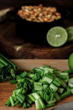 Chopped Spring Onion On Wooden Board