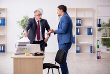 Two Male Employees Working In The Office