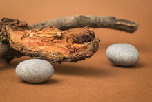 Old Wood And Stones On A Brown Background.