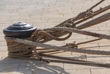 Closeup Shot Of Mooring Rope And Bollard On A Harbor