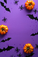 Happy Halloween Holiday Party Poster With Pumpkins, Bats, Spider On Purple Background. Flat Lay, Top View, Overhead.