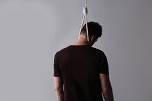 Man With Rope Noose On Neck Against Light Grey Background, Back View