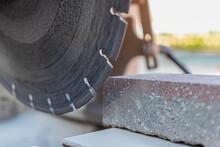 The Circular Diamond Saw Cuts Concrete Paving Slabs. Concrete Cutting Machine Close-up.