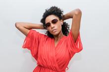 Fashionable Black Model In Sunglasses On Light Background