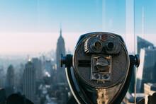Tourist Binoculars Overlooking The Manhattan Skyline In New York City At The Morning, USA, United States Of America