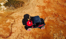 Aerial View Of Buggy Car On The Sandy On The Sea Coast Of Cyprus Or Greek In Summer. Extreme Trip Off Road Place. Outdoor Adventure For Tourists