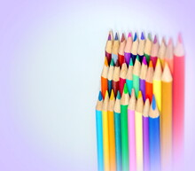 A Large Number Of Pencils Standing Upright In A Pink Vignette
