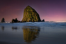 2021-08-24 HAY STACK ROCK WITH A REFLECTION ON THE BEACH IN CANNON BEACH OREGON