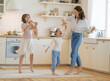 Leinwandbild Motiv Mom and her daughters are dancing.