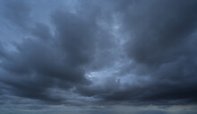 Dramatic Dark Clouds Sky With Thunder Storm And Rain. Abstract Nature Landscape Background.