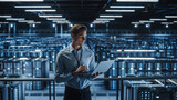 Portrait of IT Specialist Uses Laptop in Data Center. Server Farm Cloud Computing Facility with Male Maintenance Administrator Working on Cyber Security and Network Protection.