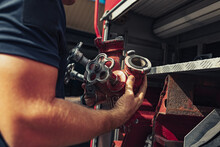 Firefighter With Special Equipment For Ambulance Firefighting