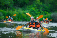 Male Kayakers Kayaking Together