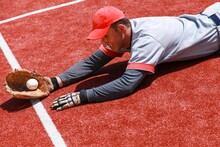 Baseball Player Diving To Catch The Ball