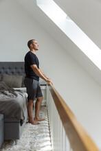Man Stretching After Awakening In Bedroom