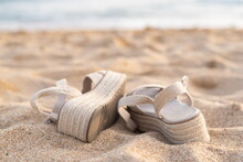 Sandals On The Sand At The Beach