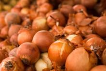 Bulb Onion In Wicker Baskets On Market Counter