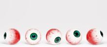 Realistic Human Eyeballs With Green Irises, 3d Rendering. Human Eyeballs On A White Background, 3d Illustration