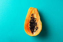 Summer Composition. Tropical Papaya Fruits Cut In Half Lie On A Blue Background. Summer Concept. Flat Lay, Top View, Copy Space