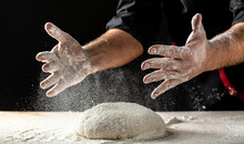 Clap Hands Of Baker With Flour. Beautiful And Strong Men's Hands Knead The Dough Make Bread, Pasta Or Pizza. Powdery Flour Flying Into Air