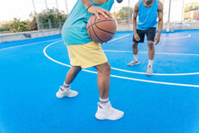 Sporty Friends Playing Basketball