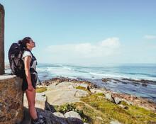 Pilgrim Woman In A High Viewpoint Against Beach And Sea