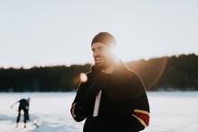 Man Standing On Frozen Lake