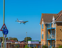 A View Of An Aircraft On Final Approach To Land At Lee On Solent, UK In Early Summer
