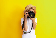 Woman Photographer With Camera In Straw Hat Making Photo, Lens