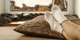 Fototapeta Kawa jest smaczna - Slim young woman legs with socks and autumn window background.