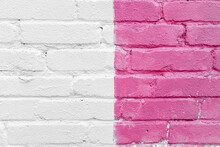 Pink And White Brick Wall Detail Texture Background. Old, Painted, Weathered And Cracked Bricks With Concrete And Stucco. Stripes On House Wall. Close Up, Copy Space