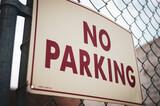Fototapeta Młodzieżowe - Old worn no parking sign on fence