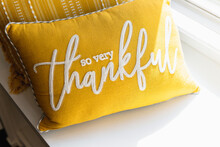 Yellow Pillow Decor With Thankful And Positive Message