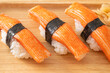 Crab Stick Sushi on wood plate