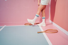 Crop Player In Sneakers With Racket On Tennis Court