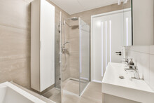 Bathroom Interior With Shower Cabin And Sink