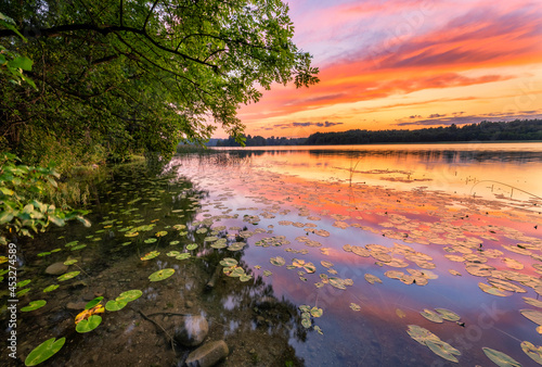 Beautiful summer sunrise over the lake