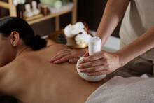 Young Woman Receiving Herbal Bag Massage In Spa Salon, Closeup