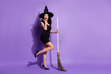 Full Size Profile Photo Of Impressed Brunette Lady Stand With Broom Wear Black Dress Shoes Cap Isolated On Lilac Background