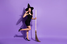 Full Size Profile Photo Of Impressed Nice Brunette Lady Stand With Broom Wear Black Dress Shoes Cap Isolated On Lilac Background