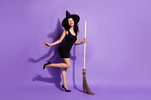 Full Size Profile Photo Of Optimistic Nice Brunette Lady Stand With Broom Wear Black Dress Shoes Cap Isolated On Lilac Color Background
